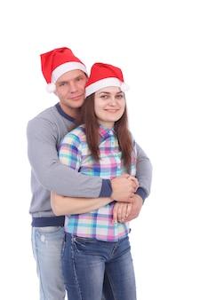 Hübsches junges paar mit weihnachtsmannmützen