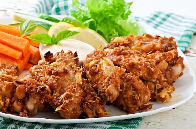 Hühnerflügel mit parmesankäseparmesankäse im ofen