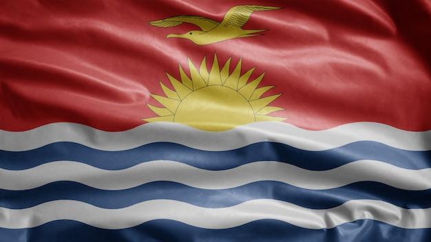 Ikiribati-flagge weht im wind. nahaufnahme von kirgisistan banner weht, weiche und glatte seide. stoff textur fähnrich hintergrund.