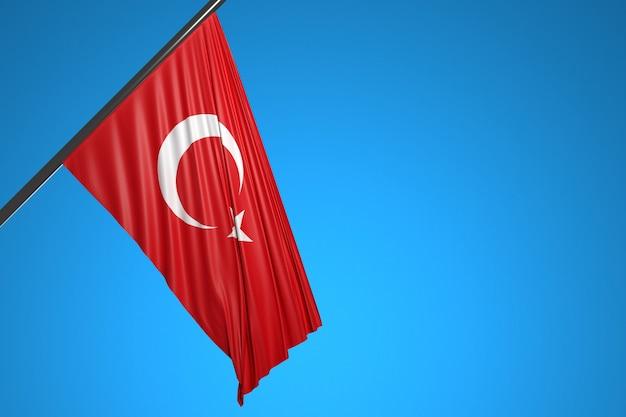 Illustration der nationalflagge der türkei auf einem metallfahnenmast, der gegen den blauen himmel flattert