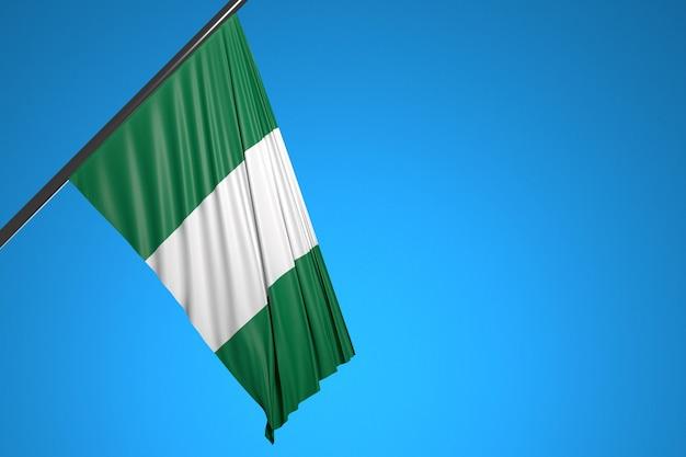 Illustration der nationalflagge von nigeria auf einem metallfahnenmast, der gegen den blauen himmel flattert