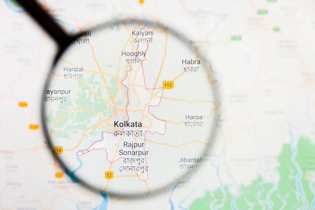 Illustratives konzept der stadtvisualisierung kolkata, indien auf anzeigebildschirm durch lupe