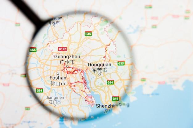 Illustratives konzept der stadtvisualisierung von guangzhou, china auf anzeigebildschirm durch lupe