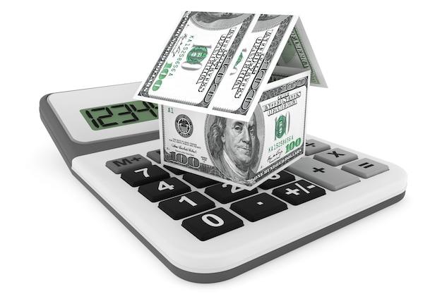 Immobiliengeschäftskonzept. dollar-banknoten als haus und taschenrechner auf weißem hintergrund