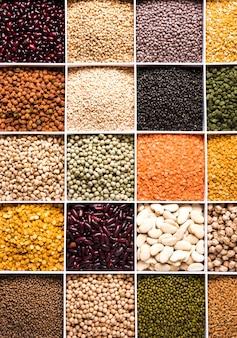 Indische bohnen, pulse, linsen, reis und weizenkorn in einer weißen holzkiste mit zellen, selektiver fokus.