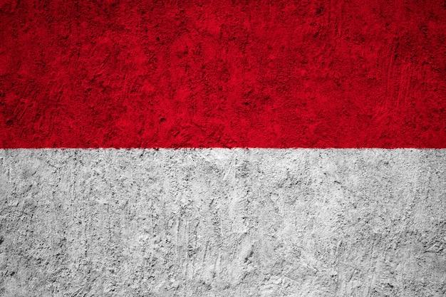 Indonesien-flagge gemalt auf schmutzwand