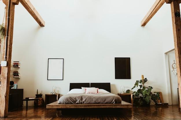 Industrielles schlafzimmer mit dunklem holzboden
