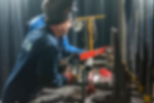 Industrieproduktion fabrik thema unschärfe hintergrund