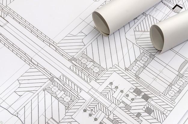 Ingenieure zeichnen mit rollen blaupause nahaufnahme