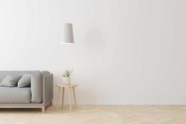Innenraum der modernen art des wohnzimmers mit grauem gewebesofa, hölzerner seitentabelle und weißer deckenleuchte auf bretterboden.