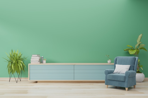 Innenraum des wohnzimmers mit kabinett und lehnsessel auf grünem wandhintergrund, wiedergabe 3d