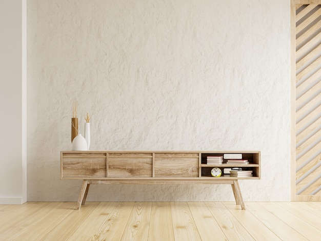 Innenwandmodell eines fernsehschranks in einem wohnzimmer auf einem betonwandhintergrund. 3d-rendering