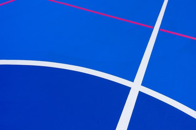 Intensiver blauer basketballplatzhintergrund