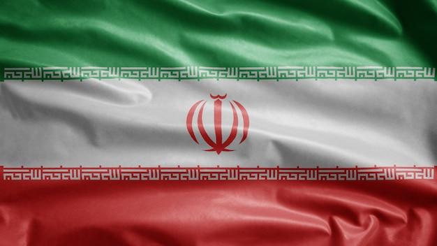 Iranische flagge weht im wind. schließen sie oben von iran banner, das glatte seide bläst Premium Fotos