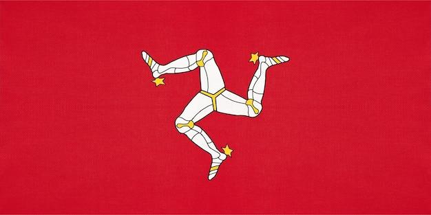 Isle of man national stoff flagge, textil hintergrund. symbol des internationalen weltlandes großbritanniens.