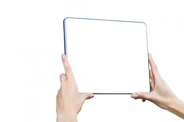 Isolieren sie tablette in den weiblichen händen - nahaufnahme, auf einem weißen hintergrund.