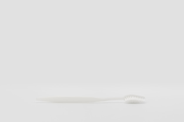 Isolierte einfache normale weiße zahnbürste wird im studiolicht auf den weißen hintergrund gelegt. beschneidungspfad.