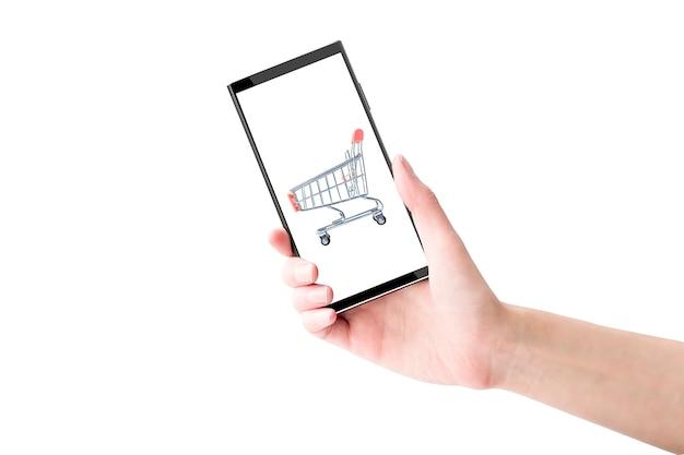 Isolierte hand hält ein mobiltelefon. online einkaufen