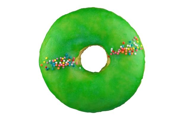 Isolierter donut mit grüner glasur. auf den stapel geschossen. durch stapeln fotografiert.
