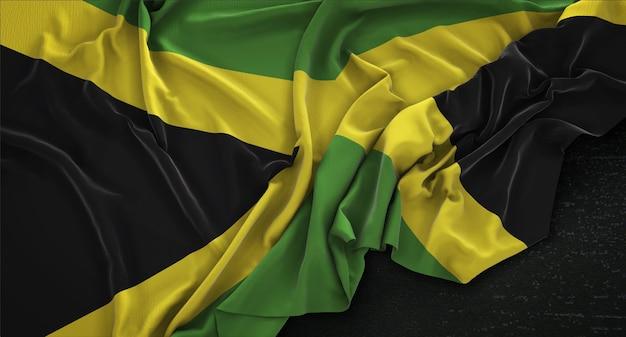 Jamaika-flagge geknickt auf dunklem hintergrund 3d render