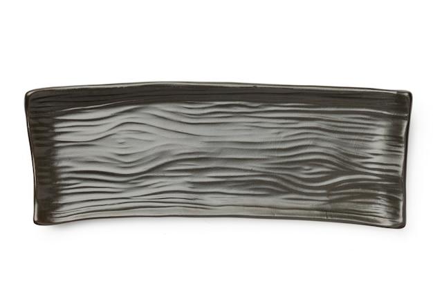 Japanische keramik leere platte quadratischen geometrischen stil dunkel isoliert auf weißem hintergrund draufsicht