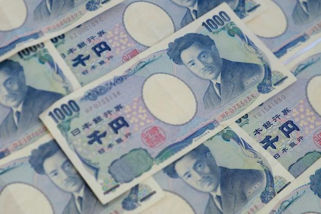 Japanische währungsbanknote von 1000yen hintergrundbild des selektiven fokus.