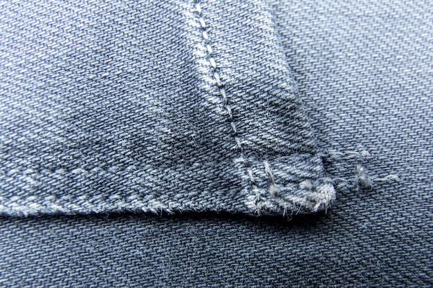 Jeanshintergrunddenim / jeanshintergrund mit naht des jeansmodedesigns / jeansbeschaffenheit mit nähten.