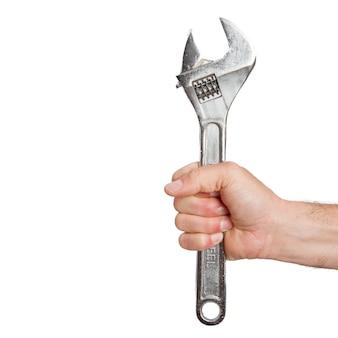 Jemand der hand hält schraubenschlüssel