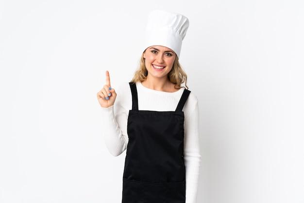 Junge brasilianische kochfrau lokalisiert auf weißem zeigen und anheben eines fingers im zeichen des besten