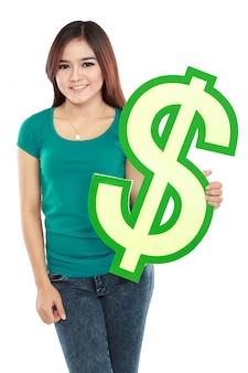 Junge frau, die dollarzeichen hält