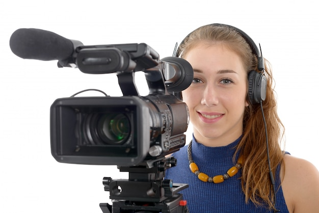 Junge frau mit einer videokamera