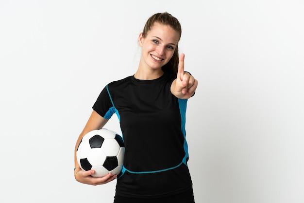 Junge fußballspielerin lokalisiert auf weißem hintergrund, der einen finger zeigt und hebt