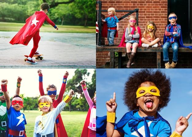 Junge kinder in der superheldkostümzusammenstellung