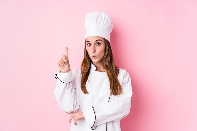 Junge kochfrau isoliert, die einige große idee, konzept der kreativität hat
