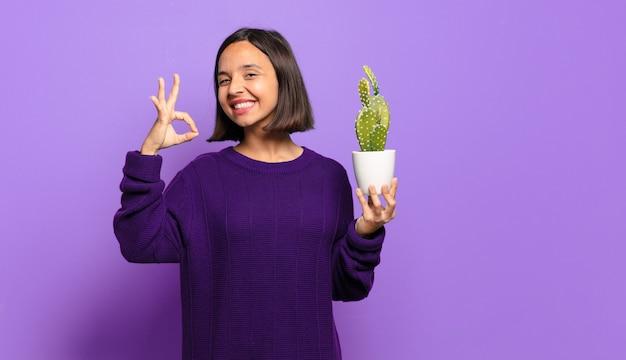 Junge vorfrau mit kaktus