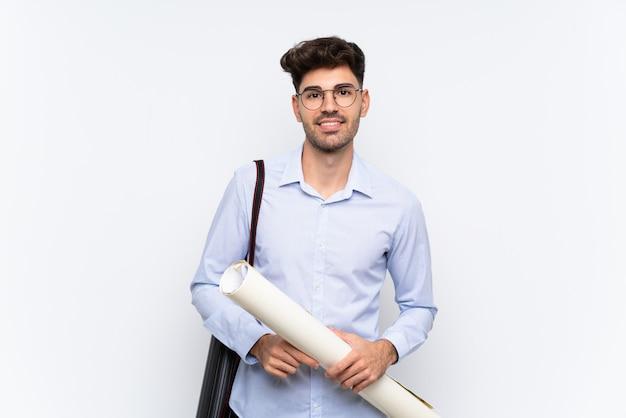 Junger architektenmann über getrenntem weißem lachen