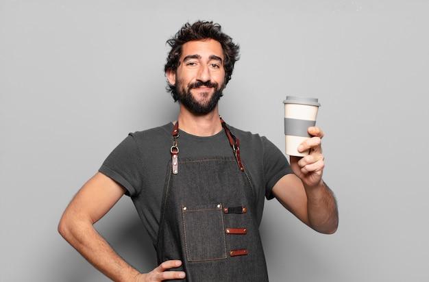 Junger bärtiger mann mit einem kaffee zum mitnehmen