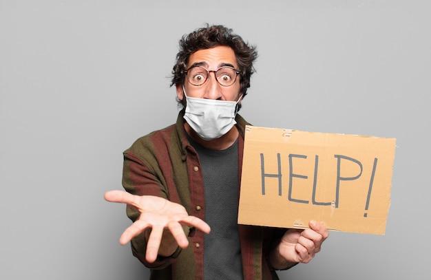 Junger bärtiger mann mit medizinischem maskenhilfekonzept