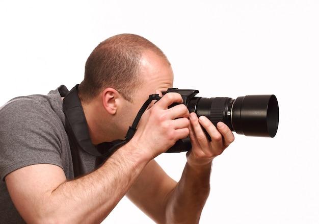 Junger fotograf, der foto macht