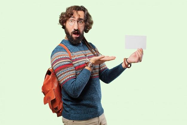 Junger hippiemann mit einem plakat
