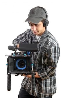 Junger kameramann mit filmkamera