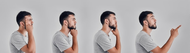 Junger mann im studio auf grauem hintergrund
