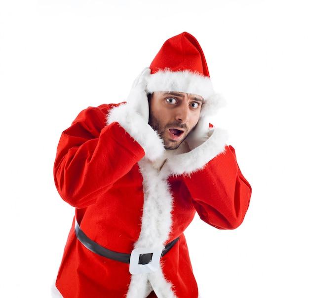 Junger weihnachtsmann lokalisiert auf weißem hintergrund