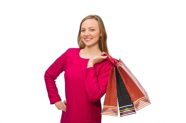 Käufermädchen im rosa kleid, das plastiktaschen hält