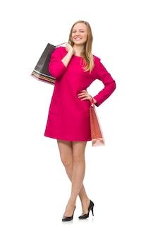 Käufermädchen im rosa kleid, das plastiktaschen lokalisiert hält