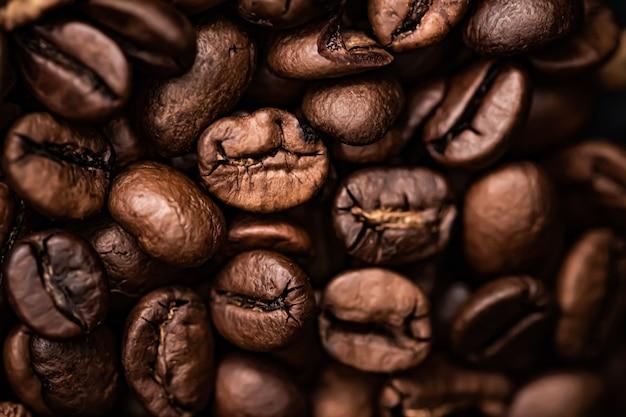 Kaffeebohnen hintergrund geröstete signaturbohne mit reichem geschmack bestes morgengetränk und luxusmischung