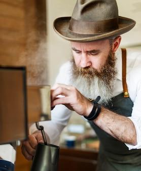 Kaffeemühle barista appliance apron steam apron concept