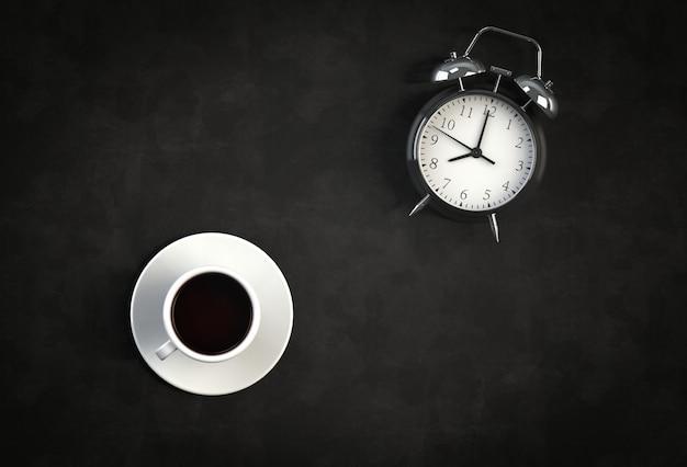 Kaffeetasse mit wecker auf schwarzem hintergrund