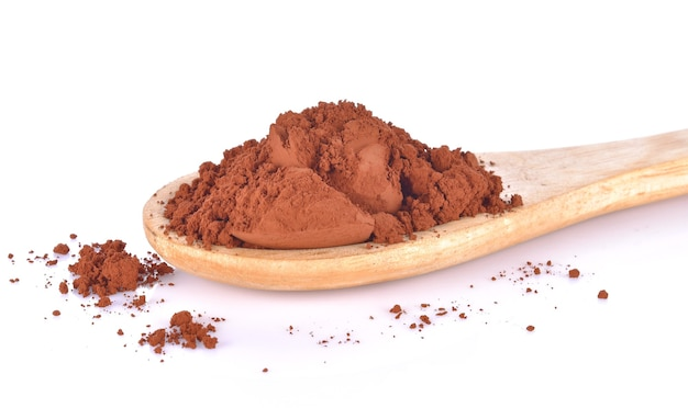 Kakaopulver in einem holzlöffel