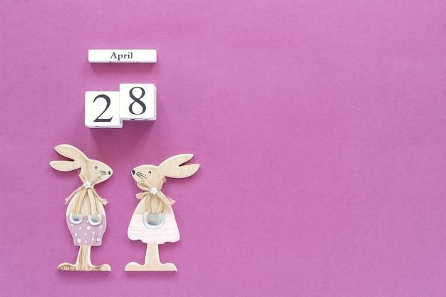 Kalender 28. april und osterhasen auf lila hintergrund. konzept christliche ostern